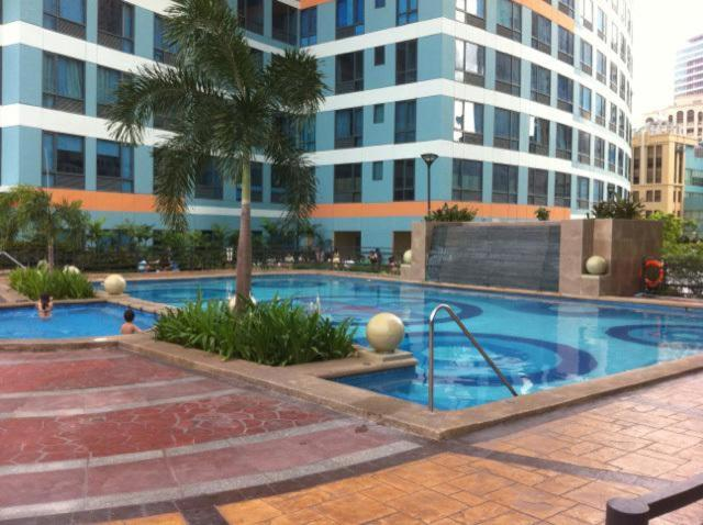 The swimming pool at or near 2BE Eastwood Park Residences