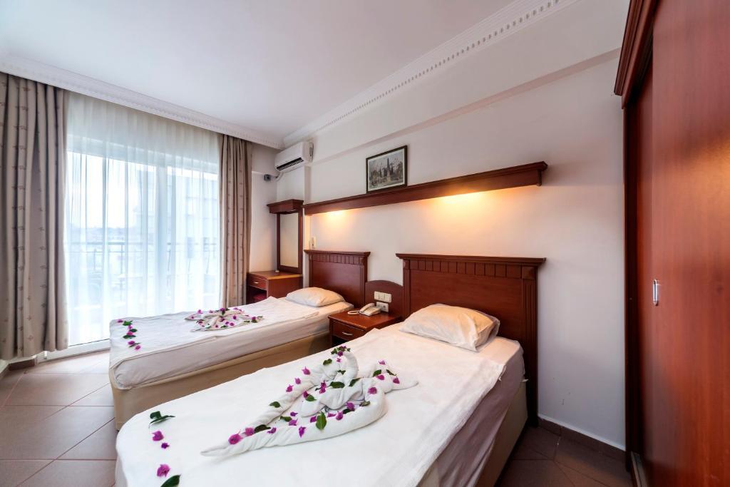 Кровать или кровати в номере Wasa Hotel