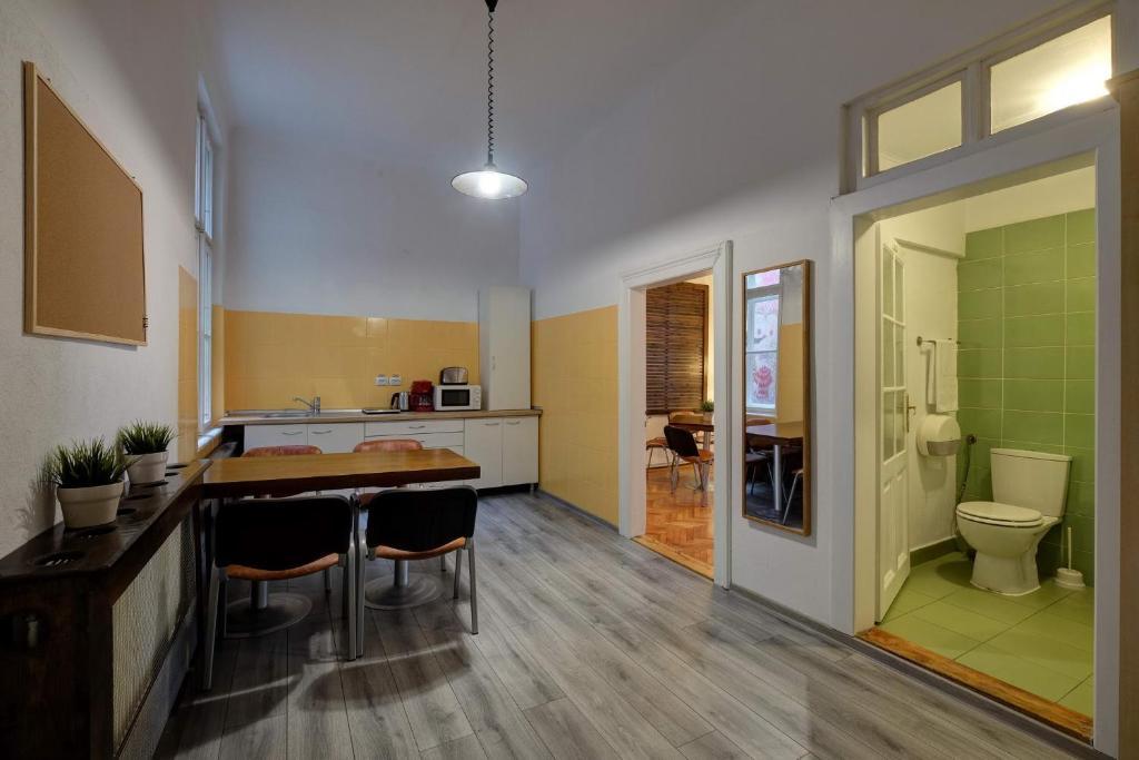 A kitchen or kitchenette at City Stay Hostel