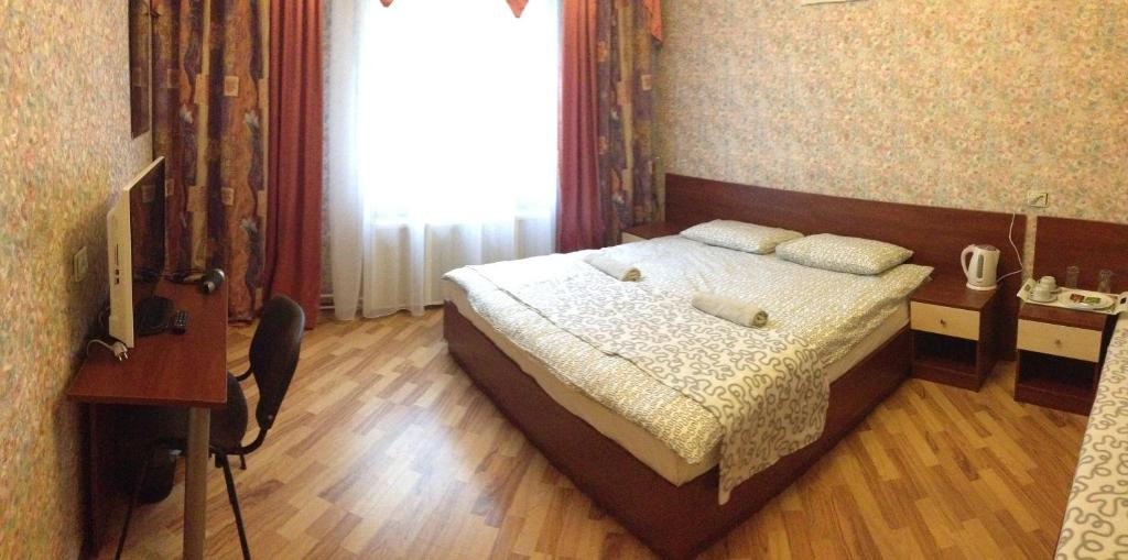 A bed or beds in a room at New
