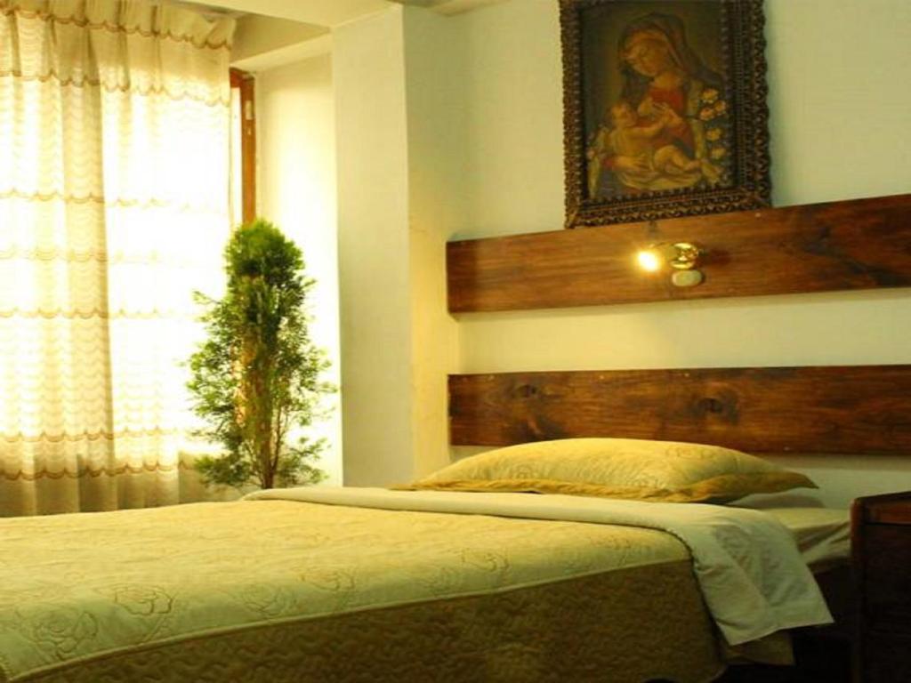 Cama o camas de una habitación en Kennedy Guest House