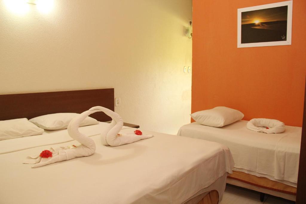 Cama ou camas em um quarto em Solar das Gaivotas Pousada