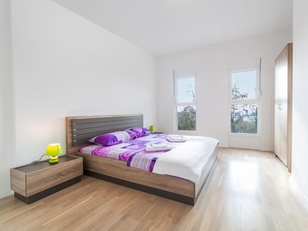 A bed or beds in a room at Bel&Rus Hestia 2