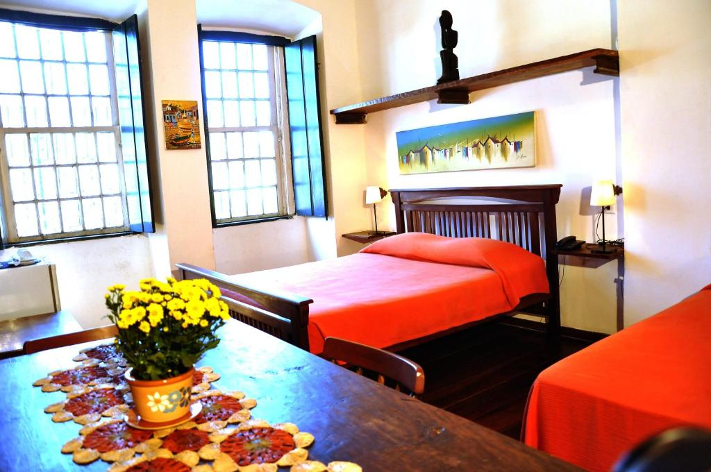A bed or beds in a room at Studio do Carmo Boutique Hotel