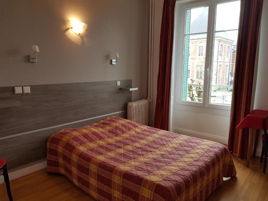 Un ou plusieurs lits dans un hébergement de l'établissement Hotel Saint Paul