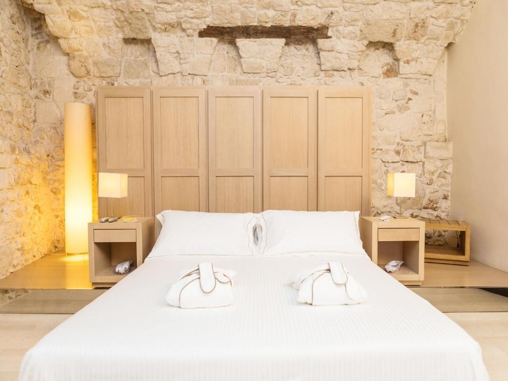 Ein Bett oder Betten in einem Zimmer der Unterkunft La Sommità Relais & Chateaux