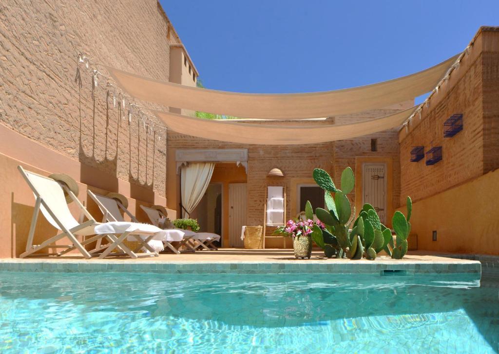 The swimming pool at or near Dar Housnia