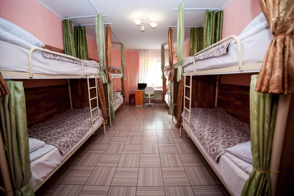A bunk bed or bunk beds in a room at Hostel Vselennaya
