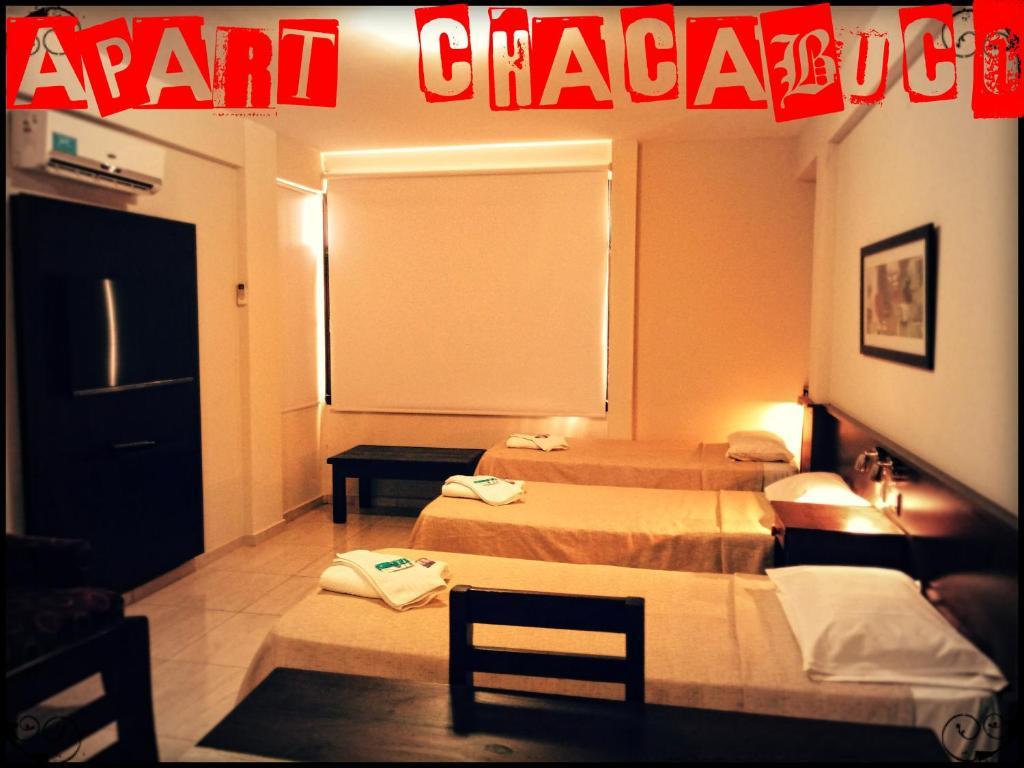 Una cama o camas en una habitación de Apart Catamarca Chacabuco