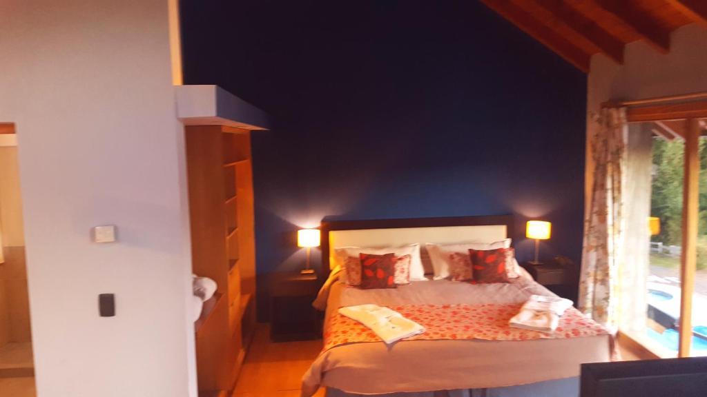 Cama ou camas em um quarto em Casa Del Bosque
