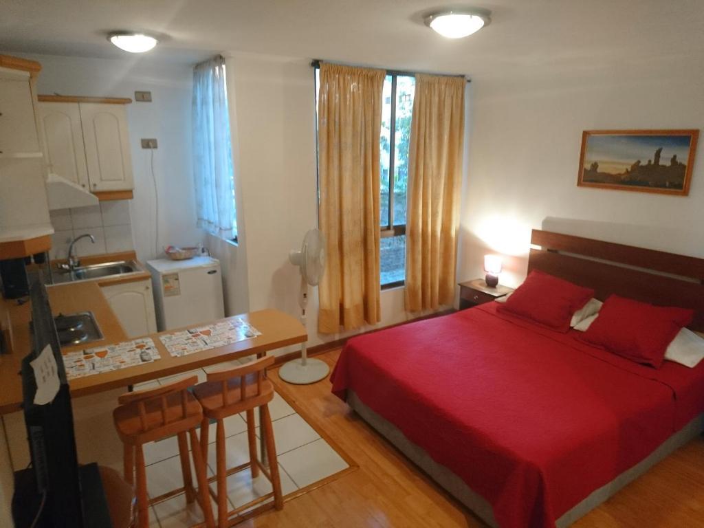 Cama o camas de una habitación en Departamento Lord Cochrane Santiago