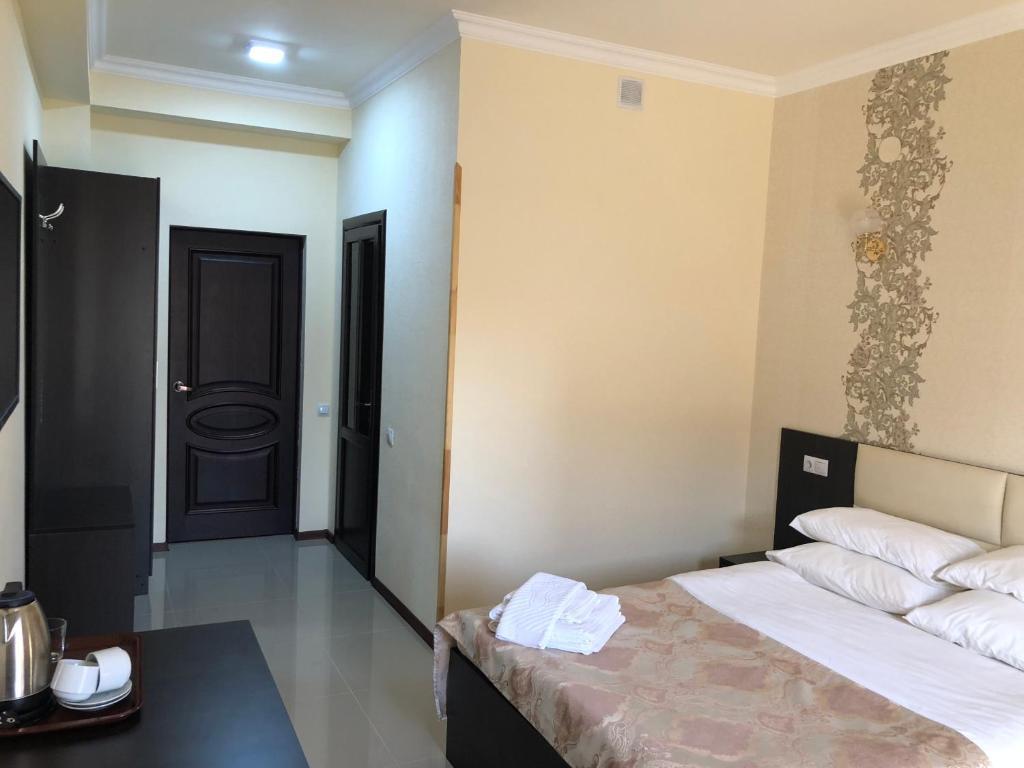 Кровать или кровати в номере Rassvet