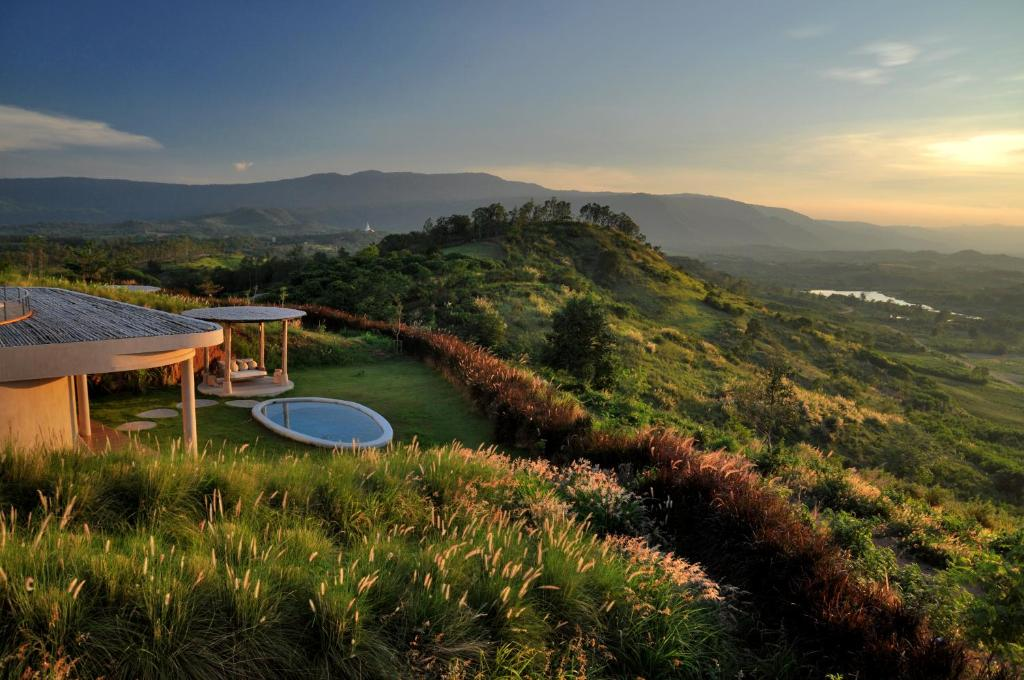 A view of the pool at Sala Khaoyai Resort or nearby