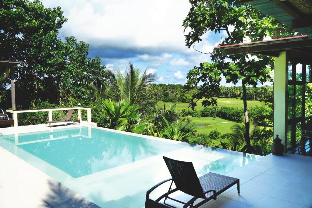 The swimming pool at or near Villa Maya