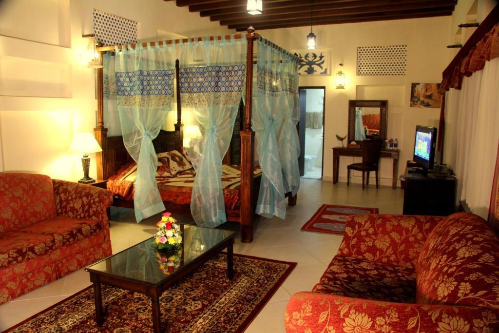 Ein Sitzbereich in der Unterkunft Ahmedia Heritage Guesthouse