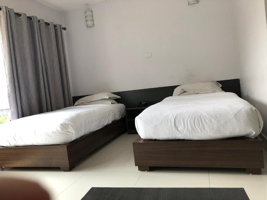 A bed or beds in a room at Bhutan Residence