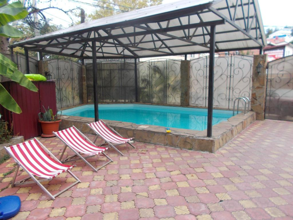 The swimming pool at or near Guest House Aton
