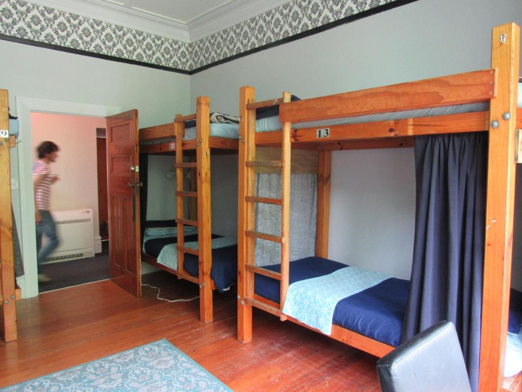 A bunk bed or bunk beds in a room at White Elephant Backpackers