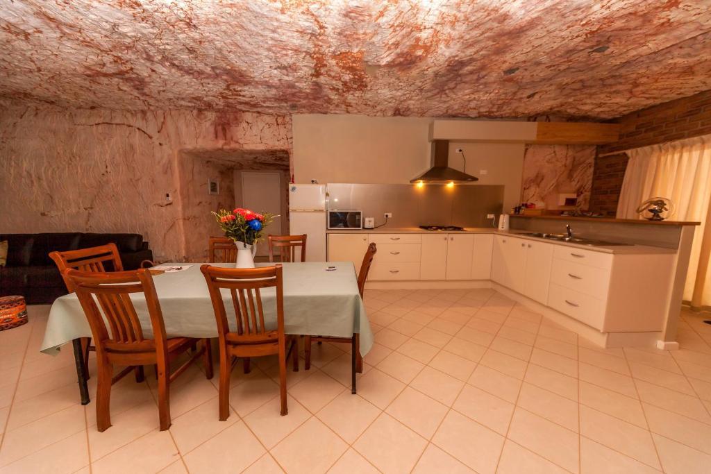 A kitchen or kitchenette at Desert Dwellers Underground B&B