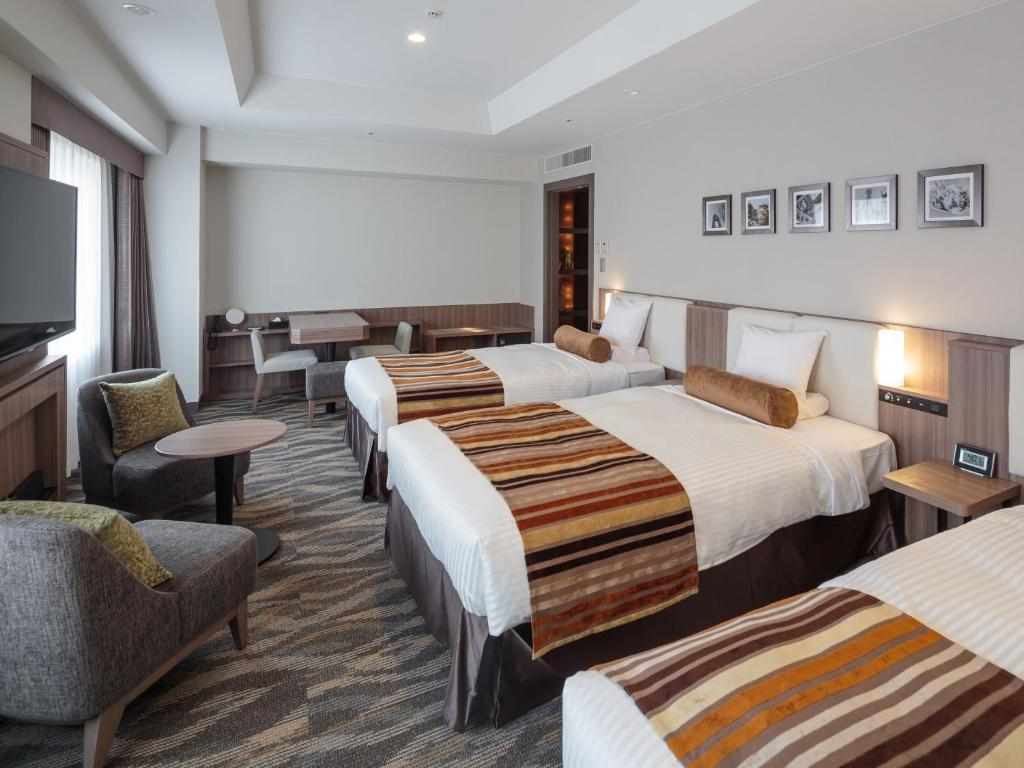 A bed or beds in a room at Hotel MYSTAYS PREMIER Dojima