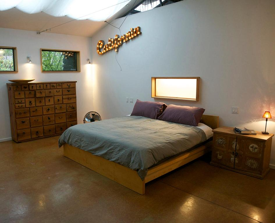 A bed or beds in a room at San Pascual Garden