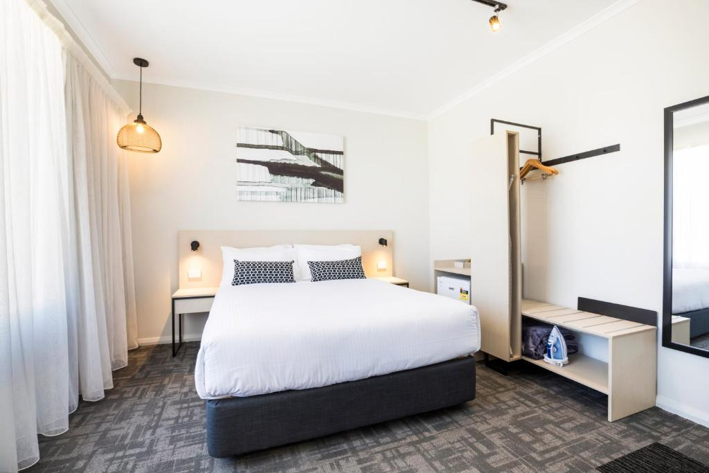 A bed or beds in a room at Nightcap at Finsbury Hotel