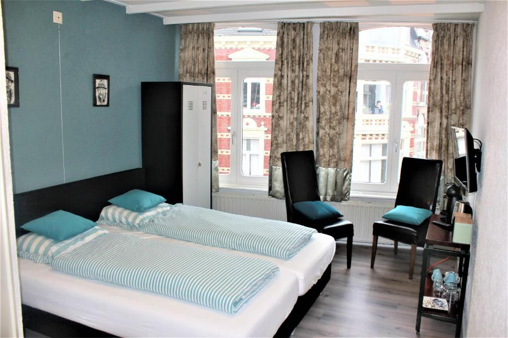 Een bed of bedden in een kamer bij B&B Bonjoere