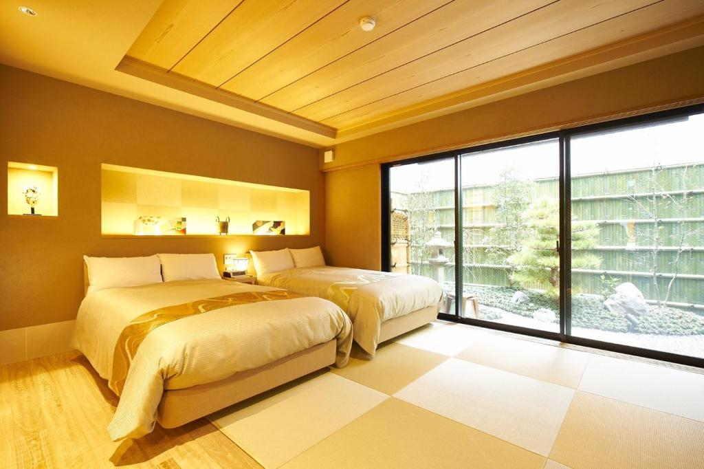 Un ou plusieurs lits dans un hébergement de l'établissement Hotel Rakurakuan