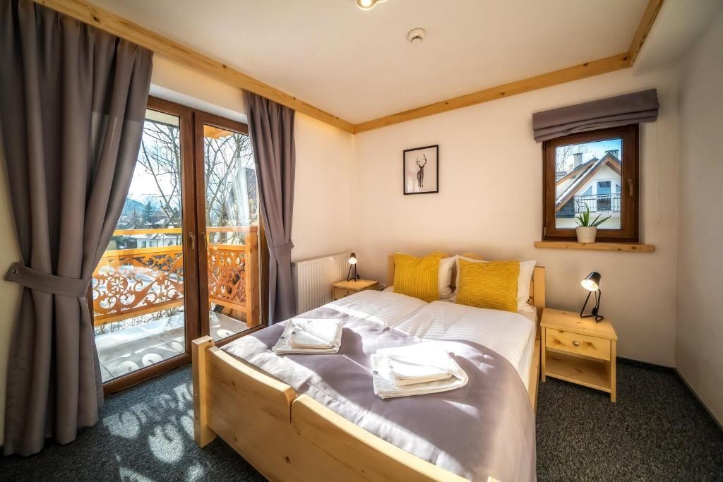 Łóżko lub łóżka w pokoju w obiekcie Villa Kaplowa Chata&SPA