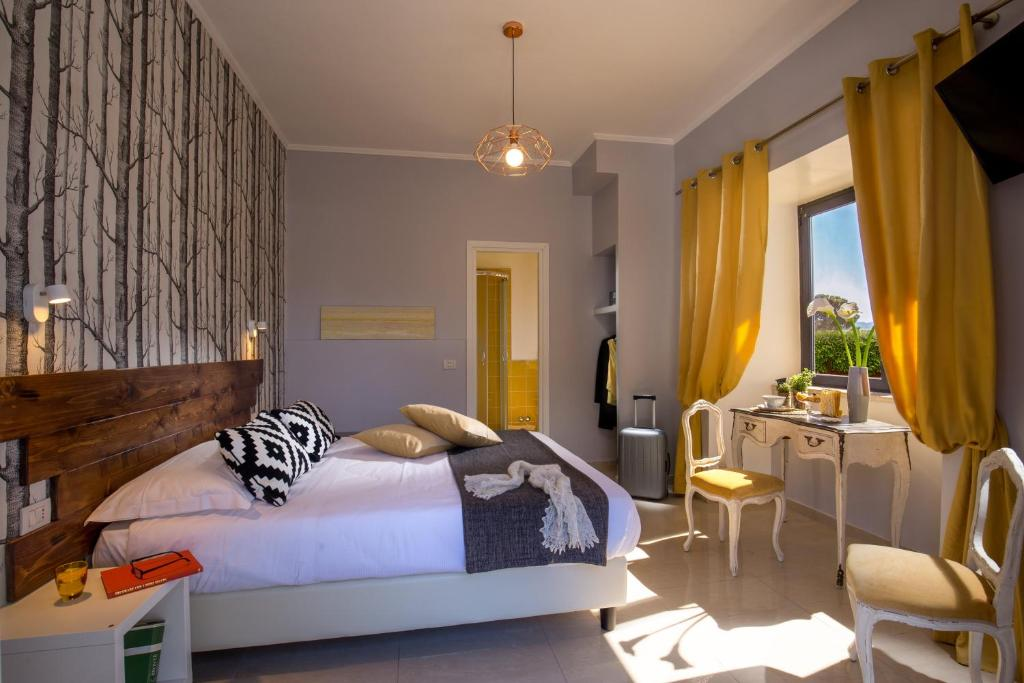 A bed or beds in a room at Urban Garden Hotel