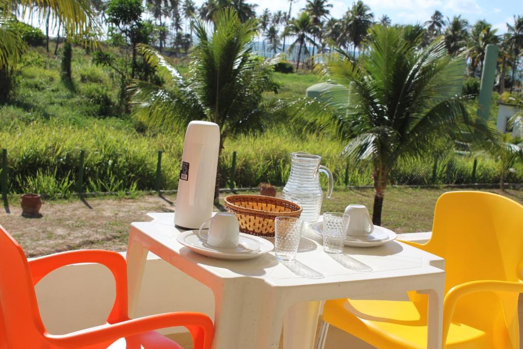 Um restaurante ou outro lugar para comer em Flats Praia do Paiva