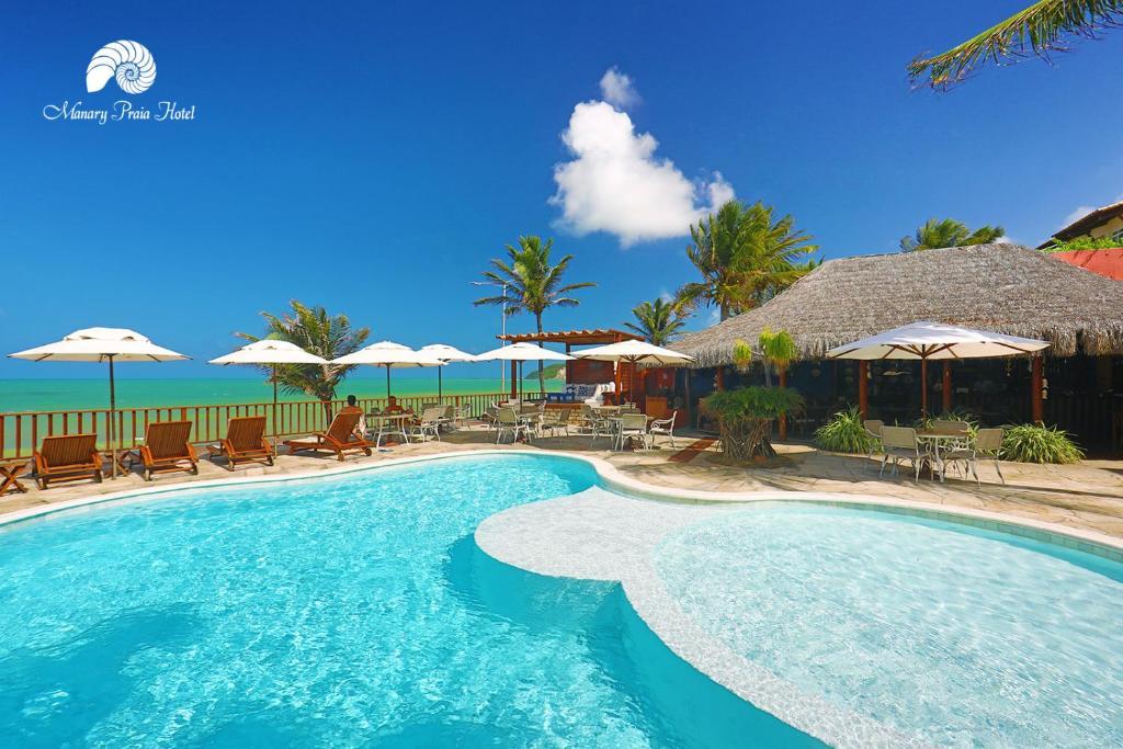 A piscina localizada em Manary Praia Hotel ou nos arredores