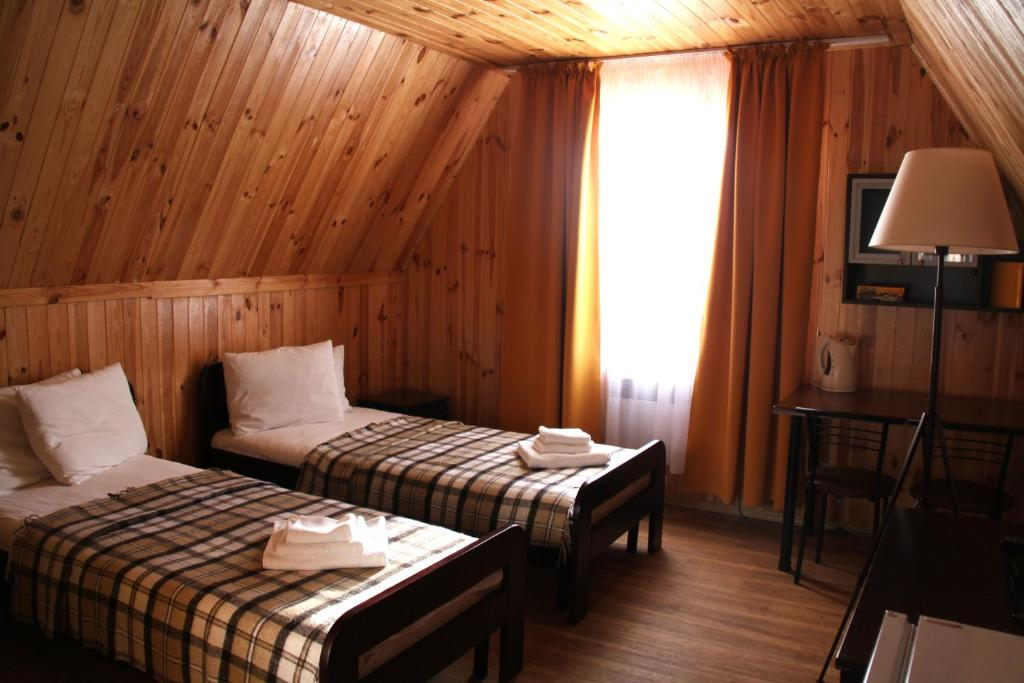 A bed or beds in a room at Eco-hotel Les na Samare