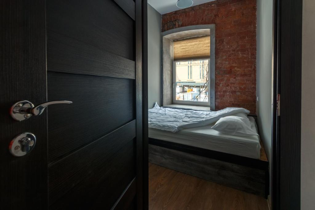 Кровать или кровати в номере Railway capsules