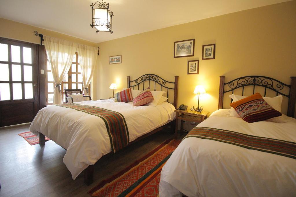 Cama o camas de una habitación en Llipimpac Guesthouse