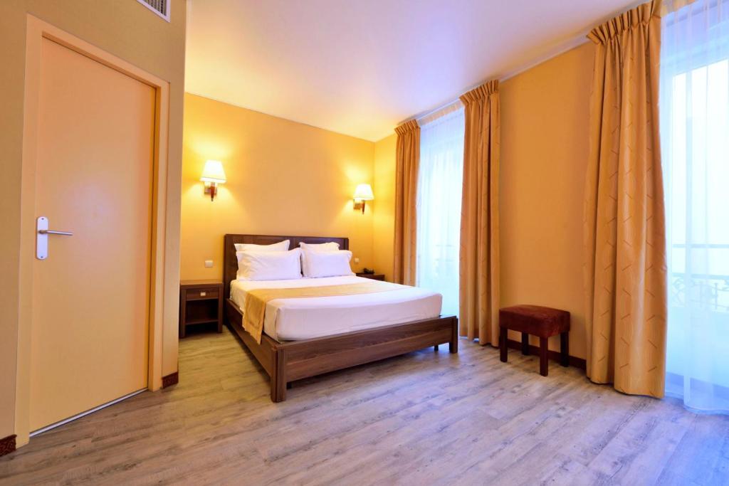Postelja oz. postelje v sobi nastanitve Hotel Capitole