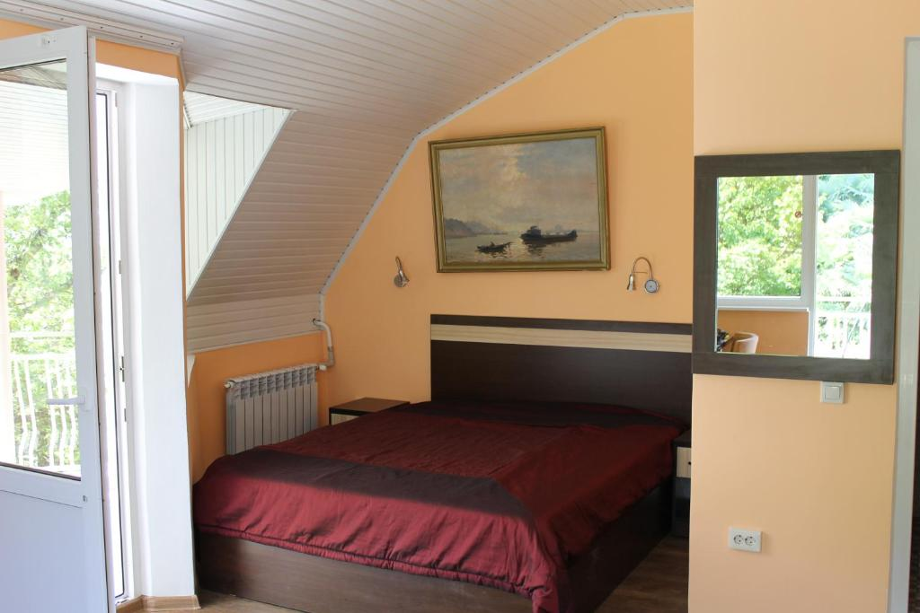 A bed or beds in a room at Guest House Na Volne