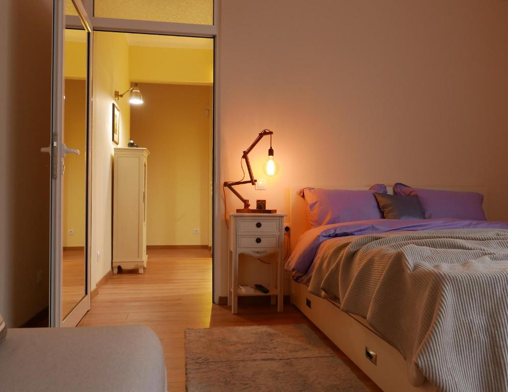 A bed or beds in a room at Vitosha 60 Apartment