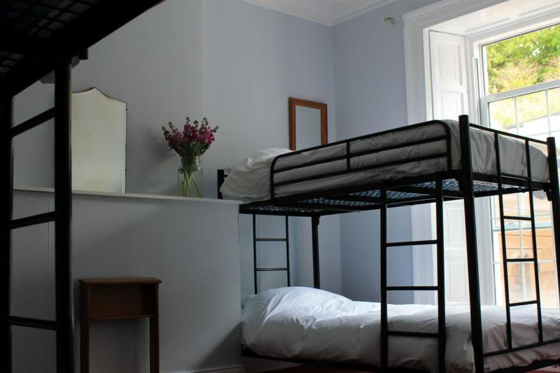 A bunk bed or bunk beds in a room at Spoon and the Stars Hostel