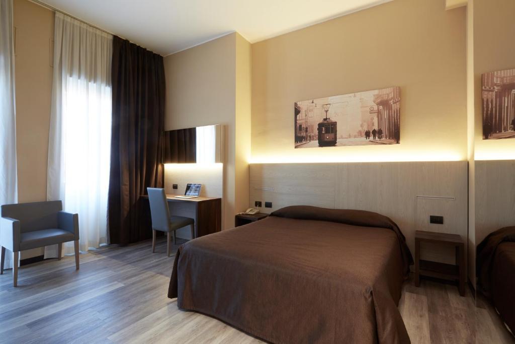 Un ou plusieurs lits dans un hébergement de l'établissement Hotel Ritter