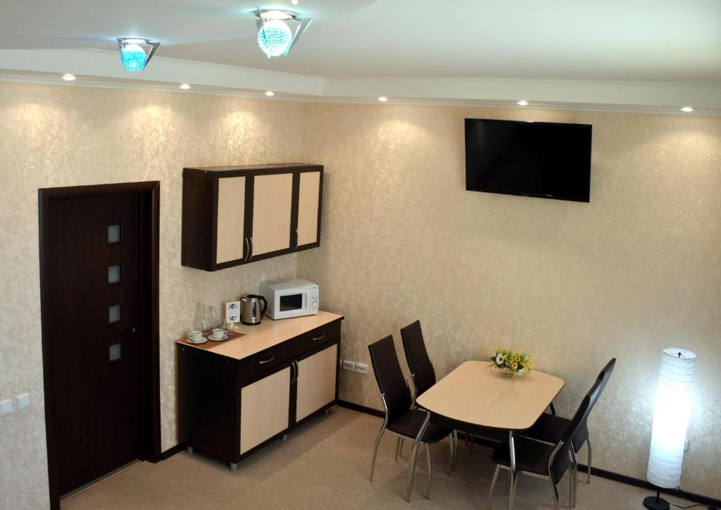A television and/or entertainment center at Hotel Veda