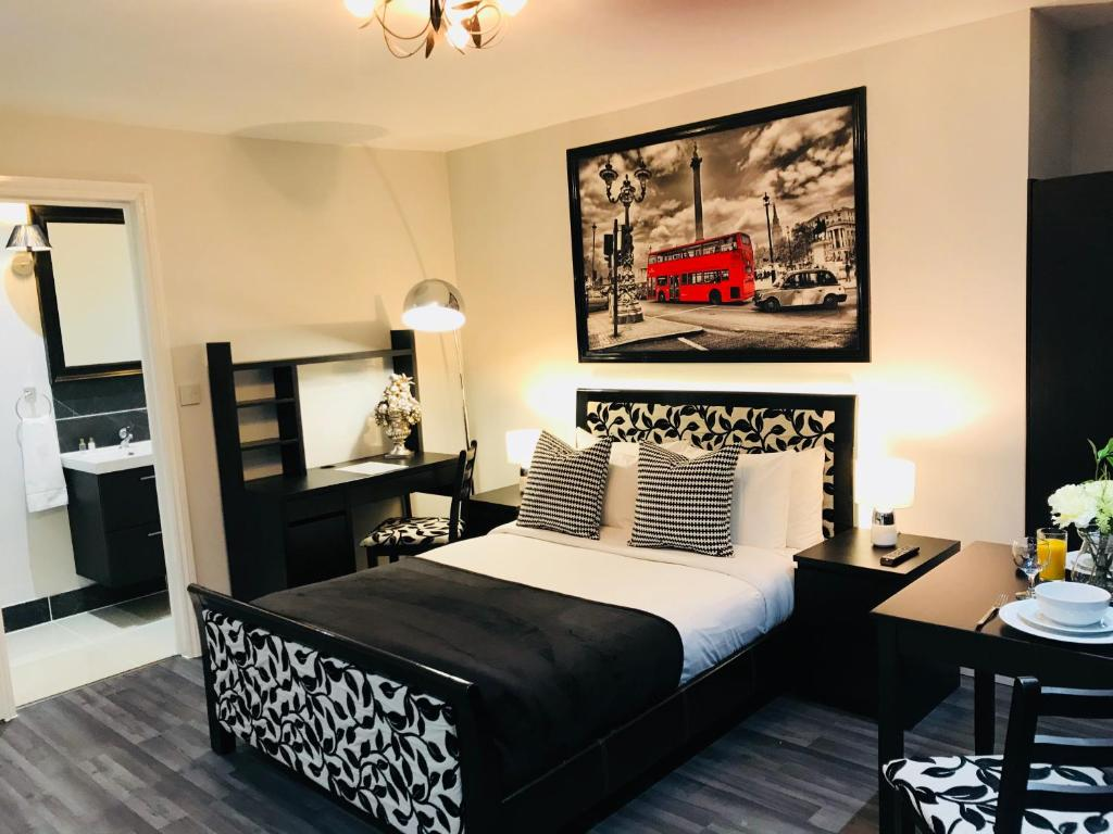 A bed or beds in a room at So Sienna Apartments