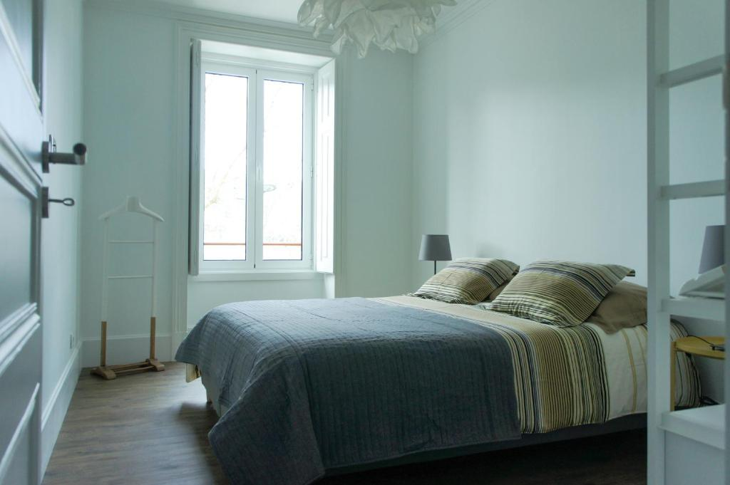 A bed or beds in a room at Villa Alba