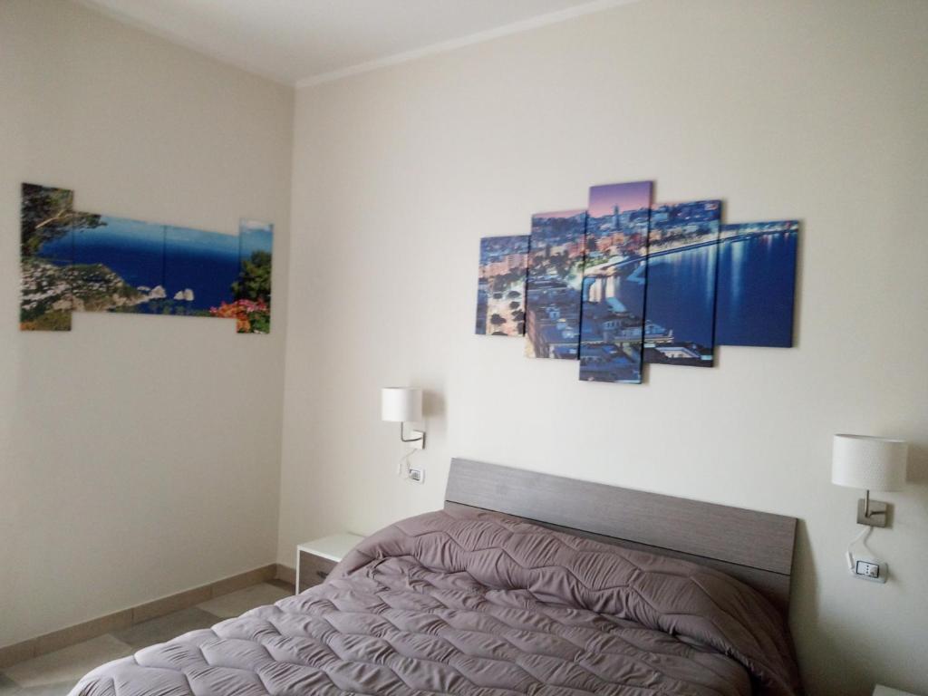 A bed or beds in a room at B&B LA DIMORA DEL CONTE