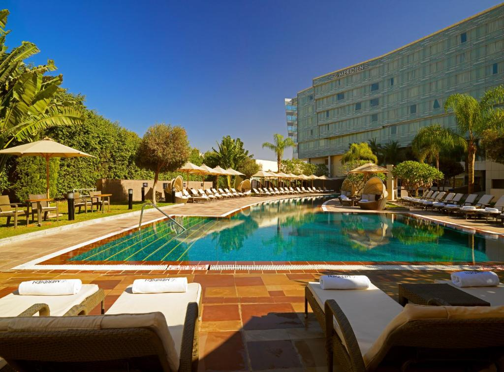 The swimming pool at or near Le Meridien Cairo Airport