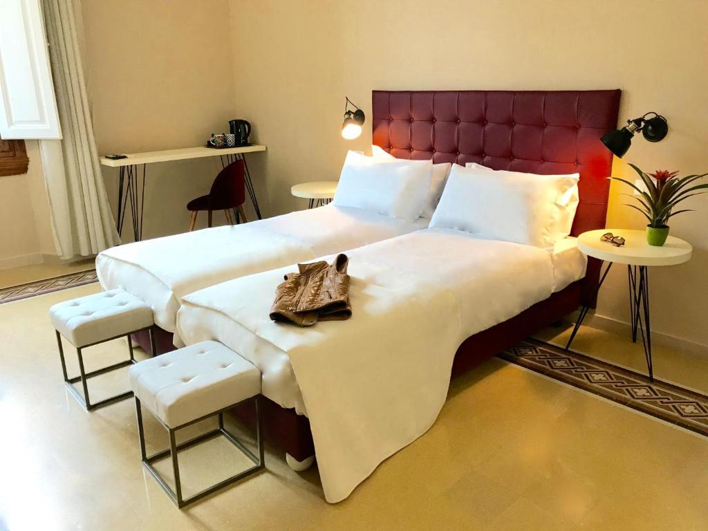 A bed or beds in a room at La Grancontessa