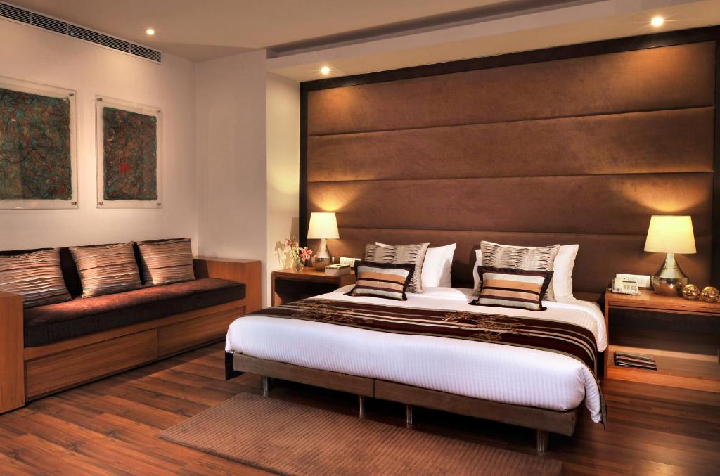 A bed or beds in a room at The Visaya - A Boutique Hotel