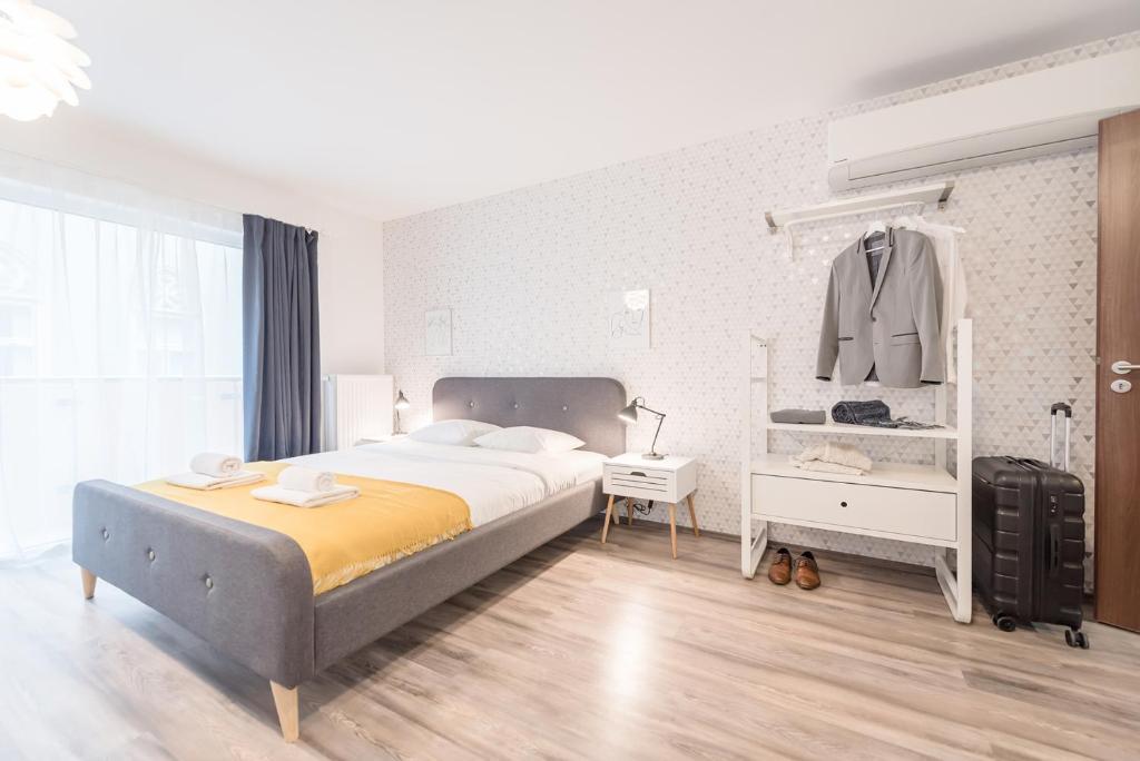 מיטה או מיטות בחדר ב-Oasis Apartments at Broadway Residence