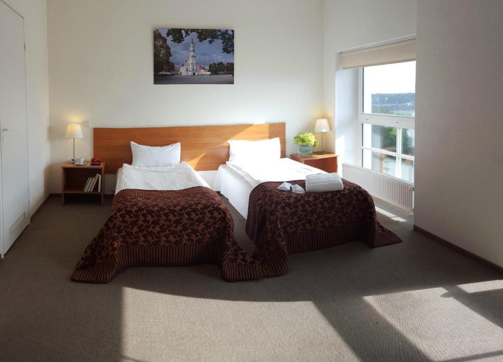 Lova arba lovos apgyvendinimo įstaigoje Centre Hotel