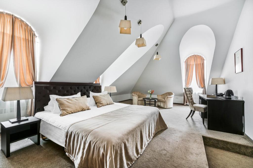 Lova arba lovos apgyvendinimo įstaigoje Amberton Cozy Hotel Kaunas